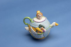 Mother Goose Tea Pot. Ceramic ornamental mother goose tea pot with mother goose riding goose stock images