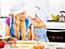 Mother and grandchild baking cookies. Royalty Free Stock Photography