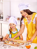 Mother and grandchild baking cookies. Stock Images