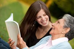 Mother and granddaughter reading Royalty Free Stock Photography