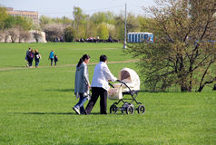 Mother, grandmother and baby on a walk. Mother, grandmother and baby on a walk in a park Stock Photography