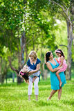 Mother, grandmother and daughters having laugh. In the park Stock Photography