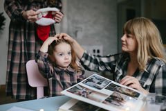 Mother, grandmother, the little girl in the room Stock Image
