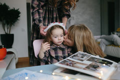 Mother, grandmother, the little girl in the room Royalty Free Stock Photos