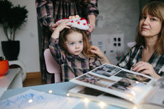 Mother, grandmother, the little girl in the room Royalty Free Stock Images