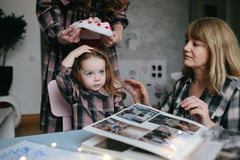 Mother, grandmother, the little girl in the room Stock Photo