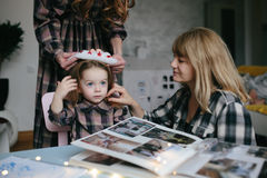 Mother, grandmother, the little girl in the room Royalty Free Stock Image