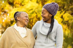Mother and grandmother smiling to each other Royalty Free Stock Photo