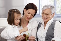 Mother granny and little girl sewing Royalty Free Stock Photography