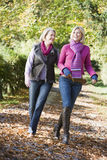 Mother and grown up daughter on walk through woods Stock Photography