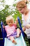 Mother guiding toddler Stock Photos