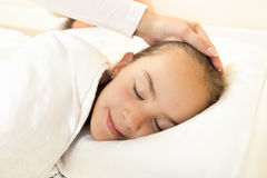Mother hand caressing sleeping daughter on hand Royalty Free Stock Photography