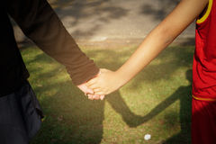 Mother hand in hand son Stock Photography