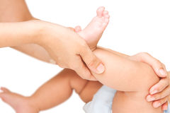 Mother hand massaging leg and foot Royalty Free Stock Photography