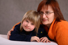 Mother and handicapped daughter stock photography
