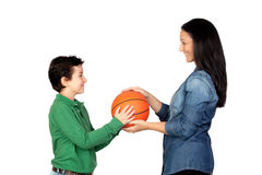 Mother handing a basketball to his son Royalty Free Stock Images