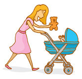 Mother handing a teddy bear to baby on a stroller Stock Photo