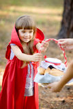 Mother hands over to the daughter a basket with food. Stock Photography