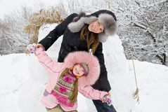 Mother happiness. Young mother and daugther in winter clothing in a winter woods Royalty Free Stock Photo