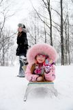 Mother happiness. Young mother and daughter in winter clothing in a winter woods Stock Photography