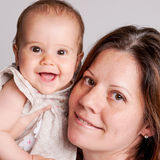 Mother and Happy Baby Girl. Stock Images