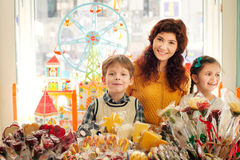Mother with happy children in the candy store Stock Image