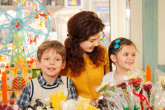 Mother with happy children in the candy store Stock Images