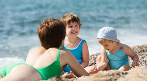 Mother with happy children at sand beach. Outdoor  of  mother with happy children at sand beach Stock Images