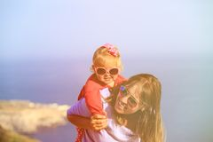 Mother and happy little daughter play on sky Stock Image