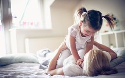 Mother have playing at morning with her baby girl. stock photo