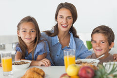 Mother having breakfast with her children Royalty Free Stock Photography