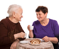 Mother having coffee with her daughter Stock Images