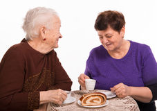Mother having coffee with her daughter Stock Image