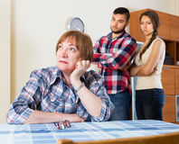 Mother having conflict with children. Sad mature mother having conflict with their children Stock Photography