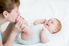 Mother having fun with her baby infant Royalty Free Stock Images