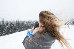 Mother having fun with her son. Winter nature. Royalty Free Stock Image