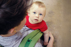 Mother having her cute little son in baby carrier Stock Photography