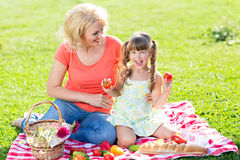 Mother having picnic with child little girl Royalty Free Stock Photos