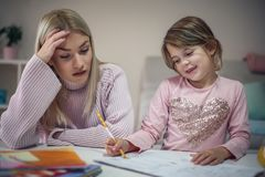 Problem about homework. Mother and daughter. stock photography
