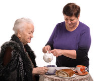 Mother having tea with her daughter Royalty Free Stock Photo