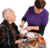 Mother having tea with her daughter Royalty Free Stock Photos