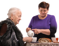 Mother having tea with her daughter Stock Photo