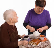 Mother having tea with her daughter Stock Image