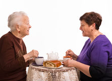 Mother having tea with her daughter Royalty Free Stock Photography