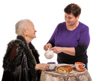 Mother having tea with her daughter Royalty Free Stock Image