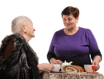 Mother having tea with her daughter Stock Photography