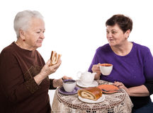 Mother having tea with her daughter Stock Photos