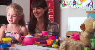 Mother Having Tea Party With Daughter And Toys In Bedroom stock video