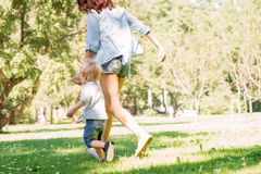 Mother having a walk with her son in the park Stock Photo