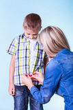 Mother help dress son fasten buttons. Royalty Free Stock Photos